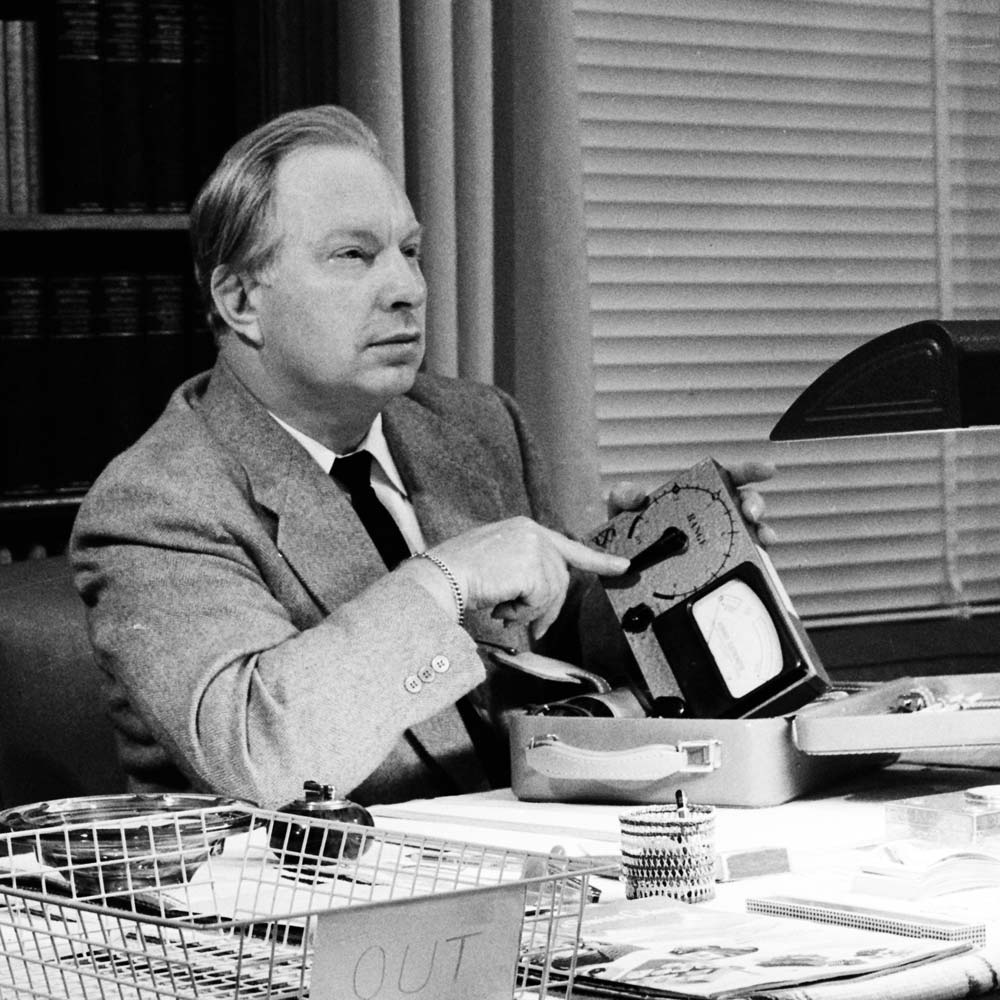 L. Ron Hubbard demonstrates his invention the E-Meter.