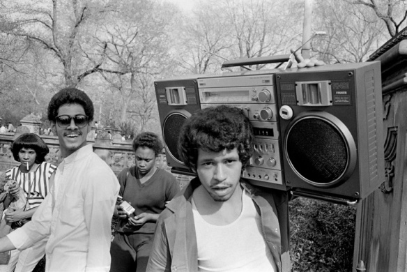 Black teen with a boombox radio