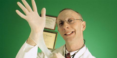 Funny doctor adjusting his rubber glove.