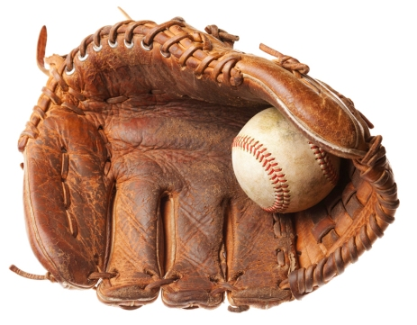 Vintage baseball glove with baseball