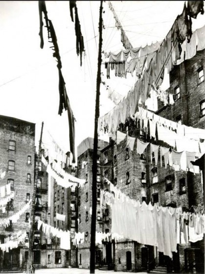 Clothes lines in a tenement backyard