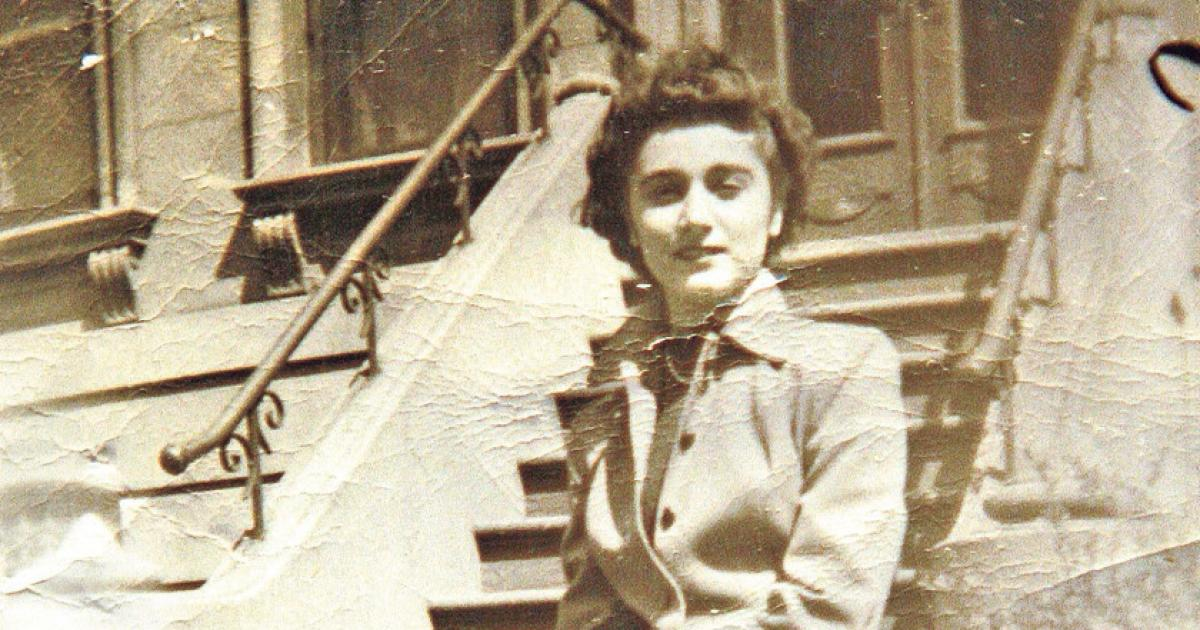 Kitty Genovese sitting on a stoop