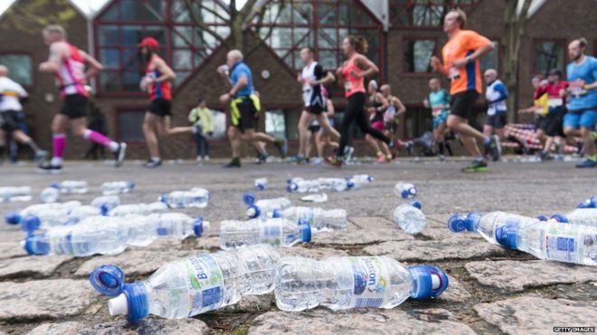 Runners and empty plastic water bottles