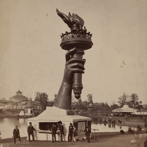 Statue of Liberty torch and hand under construction.