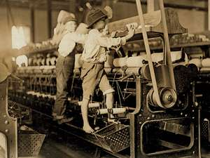 Vintage photo of young boys cleaning factory machines