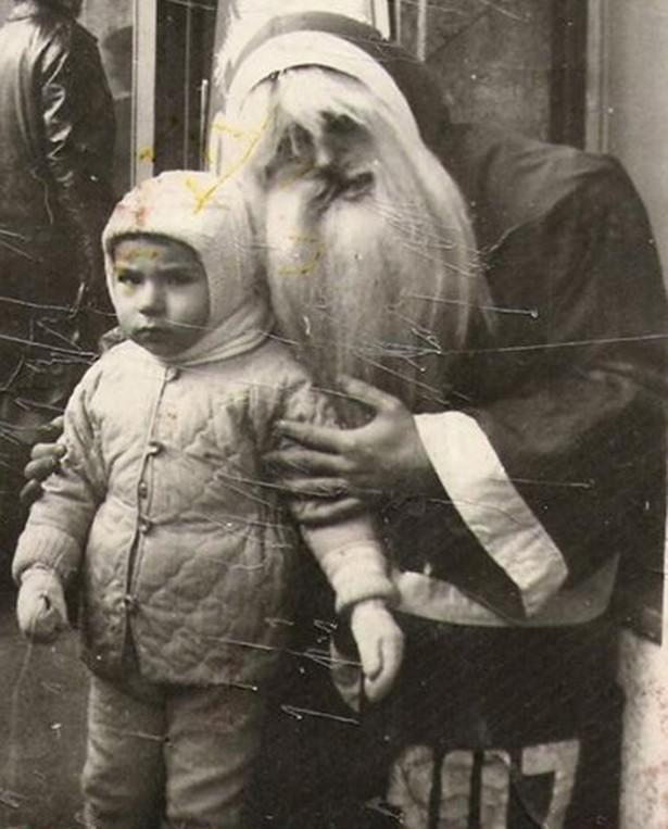 Vintage creepy Santa with child