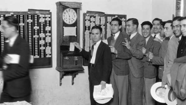 Workers at factory time clock