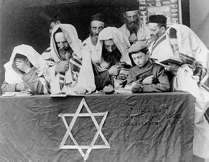 Jews praying in a synagogue
