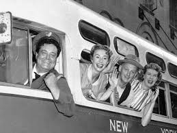 The cast of The Honeymooners on a bus.
