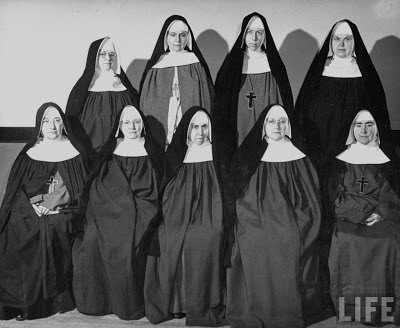 Group of unsmiling nuns