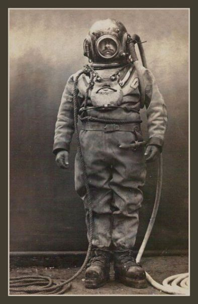 Vintage deep sea diver in bell hood.