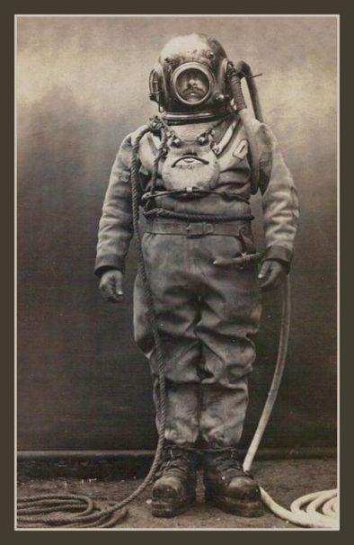 Vintage deep sea diver in bell hood.