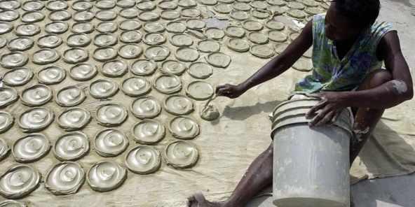 Haitian making dirt cookies.