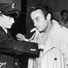 Lenny Bruce being frisked.