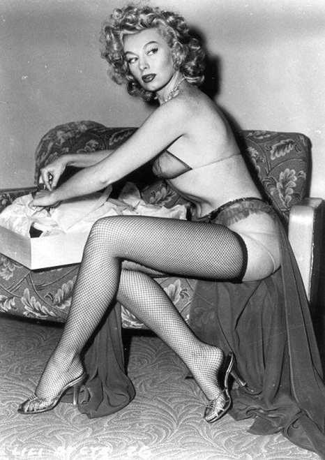 Lili St. Cyr unwrapping a box.