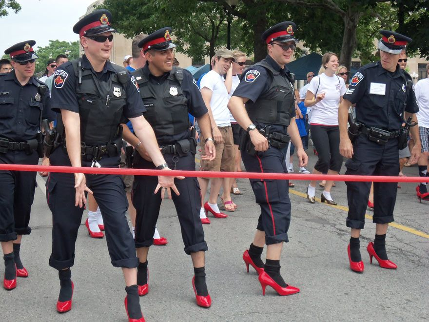 Policemen wearing red high heels