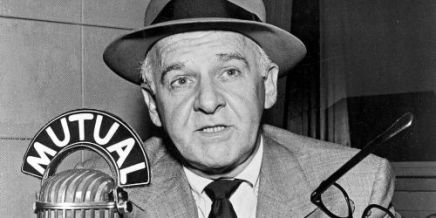 Walter Winchell at the radio microphone.