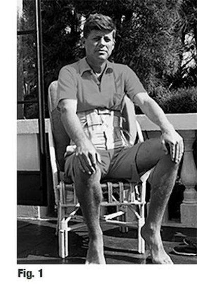 JFK in back brace