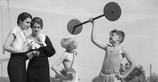 Vintage photo - young boys lifting barbell
