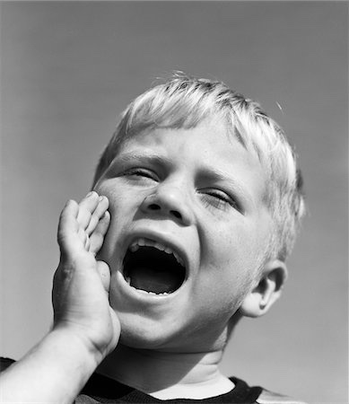 Vintage photo of young boy yelling
