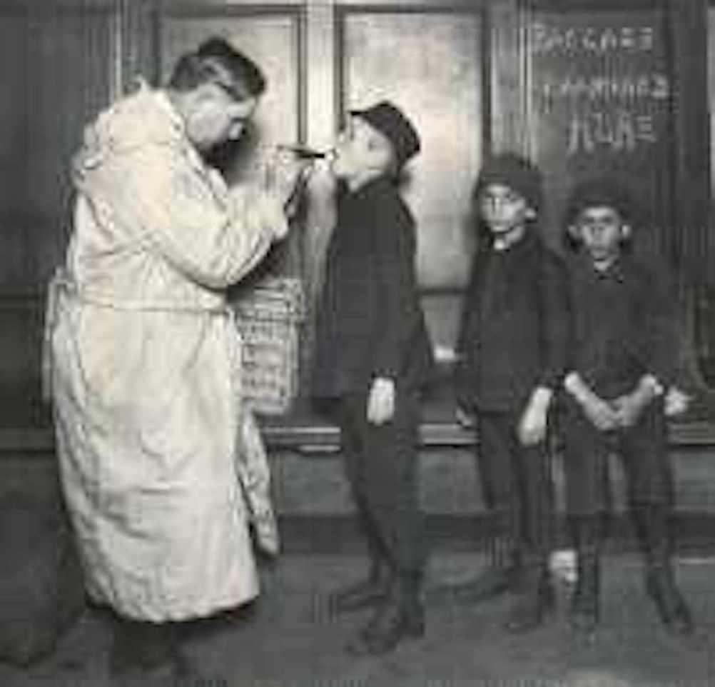 Doctor examining boys at Ellis Island