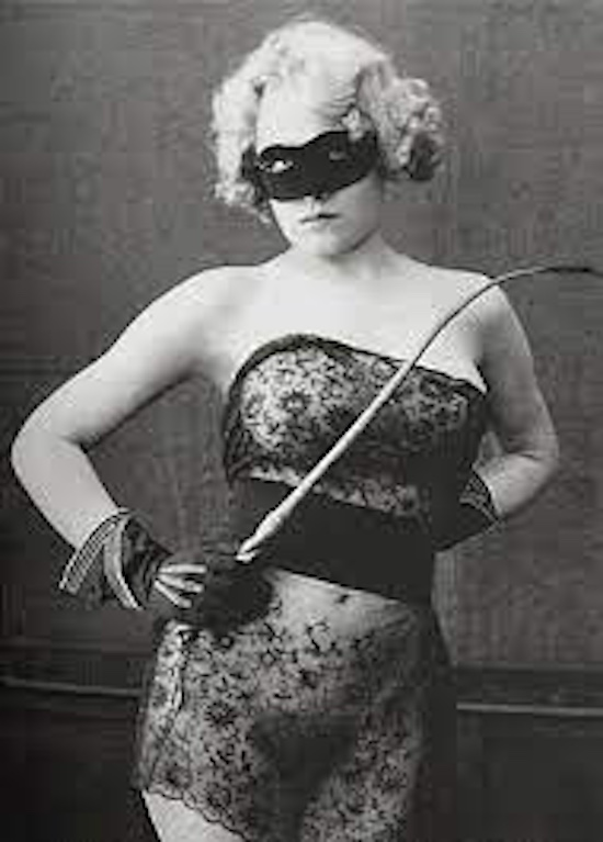 Vintage photo of S&M woman in mask